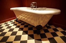 The bathroom with Victorian style roll top bath
