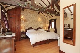 Oak beams and sonework in the large bedroom