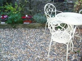 Cottage Garden with Barbecue, table and chair