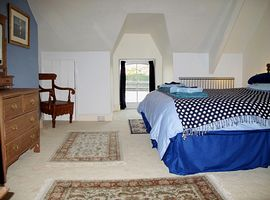 The master bedroom is spacious and luxurious