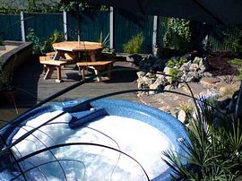 Hot tub and seating on the decked area