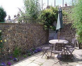 Walled Garden with garden furniture and BBQ