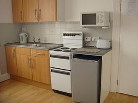 All our flats have fully equipped kitchens .
