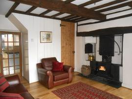 Sitting room with log stove