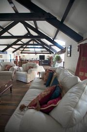 Charming lounge with wooden beams, � doors & traditional low windows