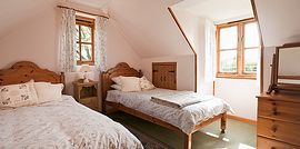 The 2nd bedroom with 2 single beds