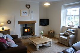 Stylish Lounge with log burner and LCD TV